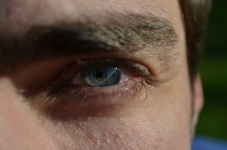 close photo of person's eye