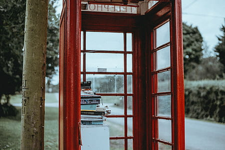 shallow focus photo of red telephone booth