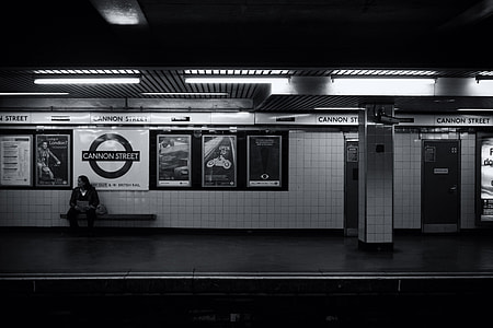 A man waits alone on the tube platform on the London Underground