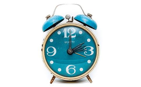blue and brown analog alarm clock