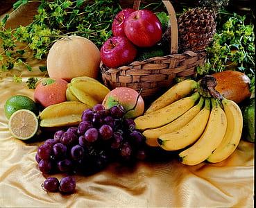 purple grape, yellow banana, and three red apples