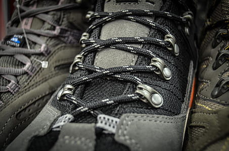 black and gray lace-up shoe close-up photography