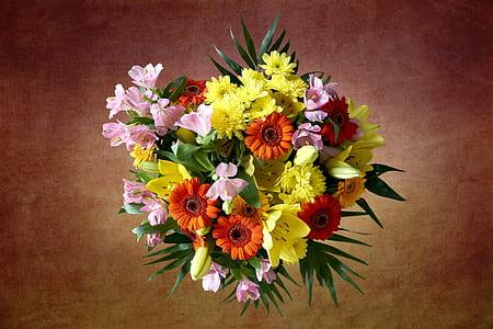 close-up photograph of yellow and orange petaled flower arrangement