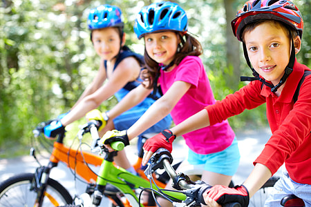 three children's riding a bike