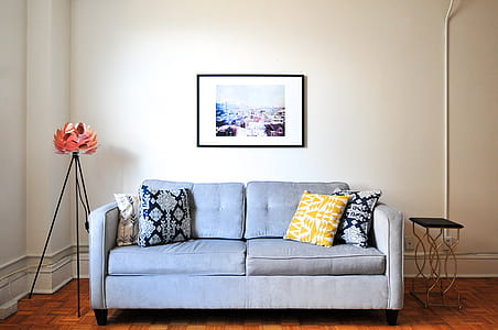 padded blue sofa and assorted-color throw pillows