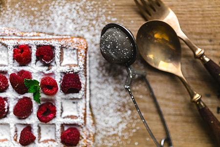 Breakfast waffles with fresh raspberries and powdered sugar