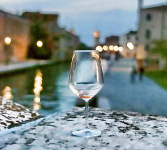 empty wine glass on white surface