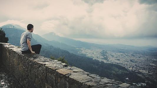 man sitting on edge