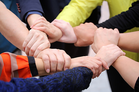 group of people holding each others wrists