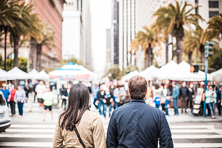 Young Couple Looking on the Other Side of the Crosswalk