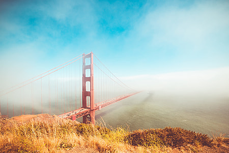 Colorful Golden Gate Bridge in Foggy But Sunny Weather