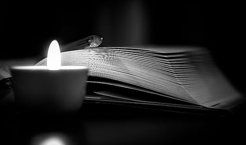 open book near candle