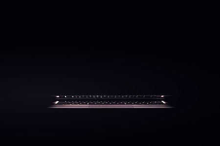 Laptop computer sitting in a dark room