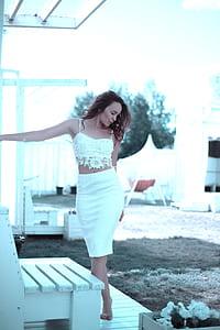 woman wearing white 2-piece spaghetti strap mini dress