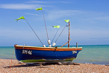 blue and brown boat docked near body of water at daytime