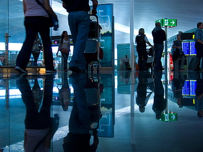photo of people walking inside building