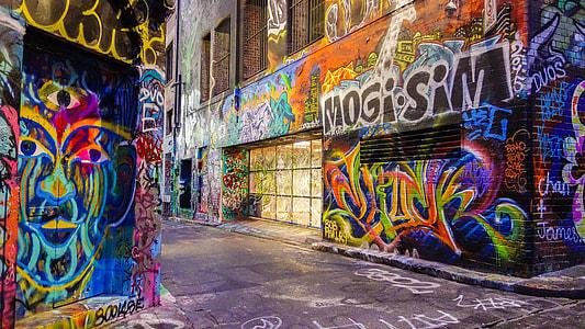 photo of street full of graffiti