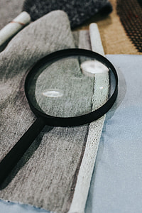 Magnifying glass with fabric on a table