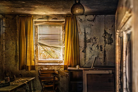 room with yellow curtains and chair near the window