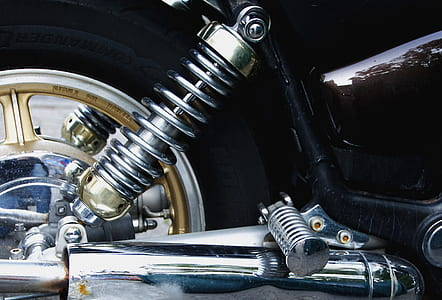 closed up photo of silver motorcycle coilover