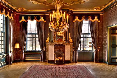 chandelier over area rug inside floral wallpaper room