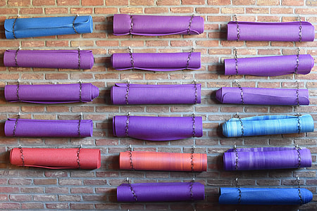 assorted-color rolled yoga mats