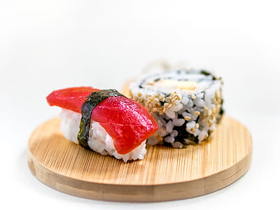 two sushi slices on top of wooden tray