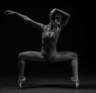 grayscale photography of Woman in leotard making post