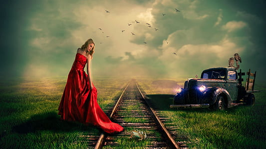 woman in red sleeveless dress standing beside train rail