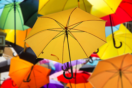 selective focus photography of yellow umbrella