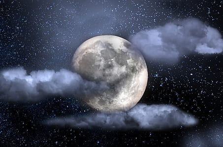 moon and clouds during night time