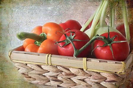 tomatoes on brown wicker basket