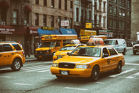 Yellow taxis and buses on the streets on Manhattan, New York City