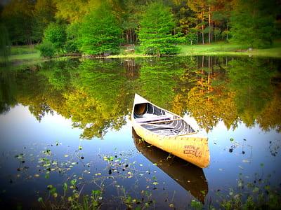 yellow canoe boat on lake
