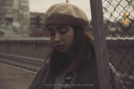 woman wearing gray knit cap movie scene
