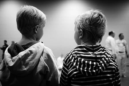 two boys staring each other