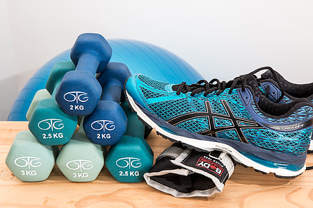 pair of teal ASICS running shoes