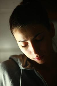 macro shot of woman wearing gray hooded top