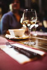 Friends at a restaurant drinking wine