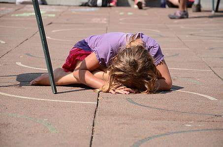 girl in purple shirt planking on floor