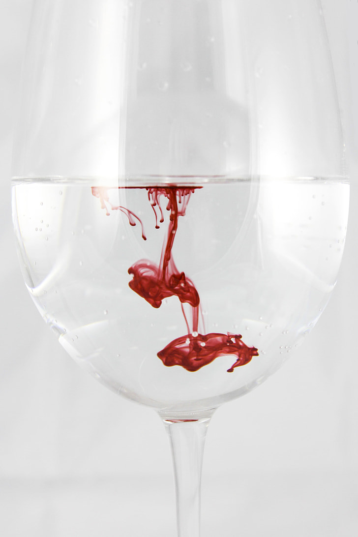 white water with blood drip on water goblet