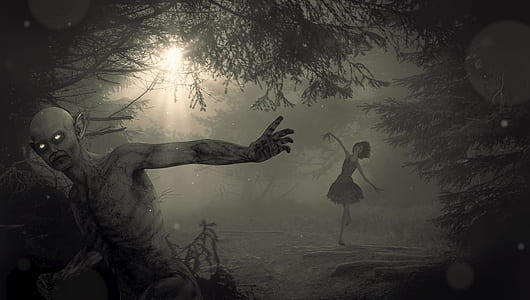 woman and topless man dancing in the woods