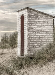 photo of white and brown wooden shed