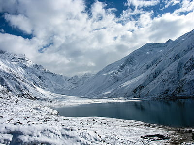 snow mountain and body of water