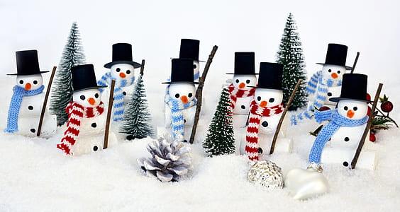 snowman figurines on snow