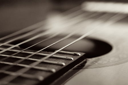 grayscale photography of string guitar