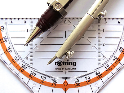 silver drafting compass on Rotring measuring tool
