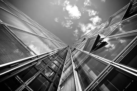 grayscale photograph of concrete building