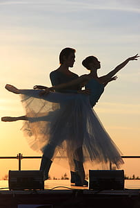 male and female ballerinas during sunset