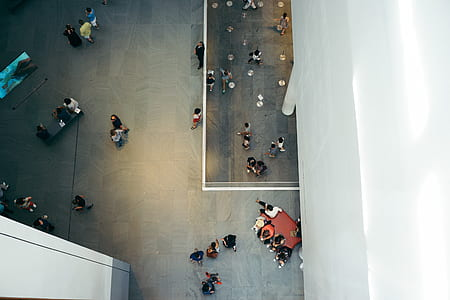 high angle view of people walking inside building